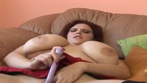 Busty MILF gets a buzz out of plowing hard