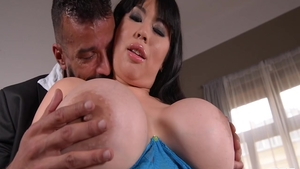 Brunette David Perry demonstrates natural tits