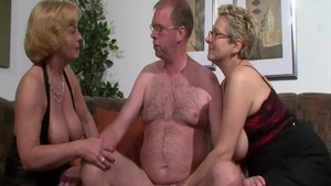 Threesome in company with busty mature