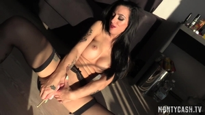 Tattooed brunette Skyler Mckay playing with sex toys