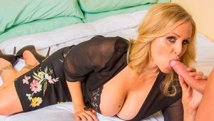 Blonde Julia Ann in lingerie romantic cowgirl sex in the bed