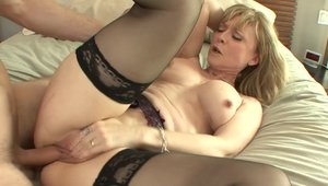 Nina Hartley rides a hard dick
